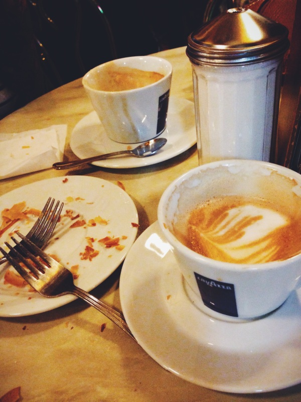 Remnants of a cafe latte and a sfogliatella at Caffe Vittoria on Hanover Street in Boston.