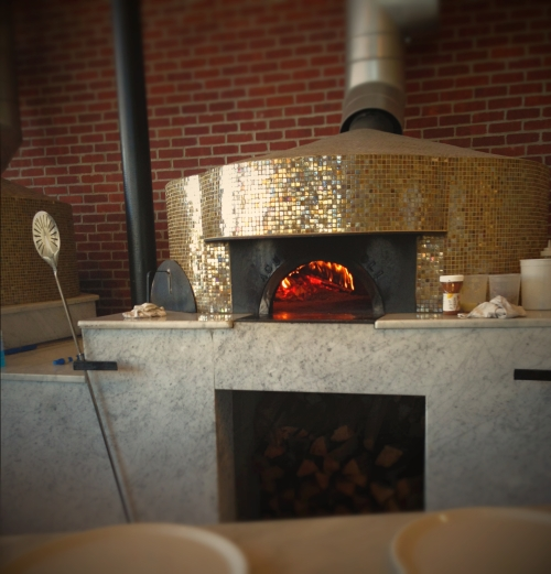 One of the wood-fire pizza ovens. The oven itself is a work of art, but what it can create is even more special.