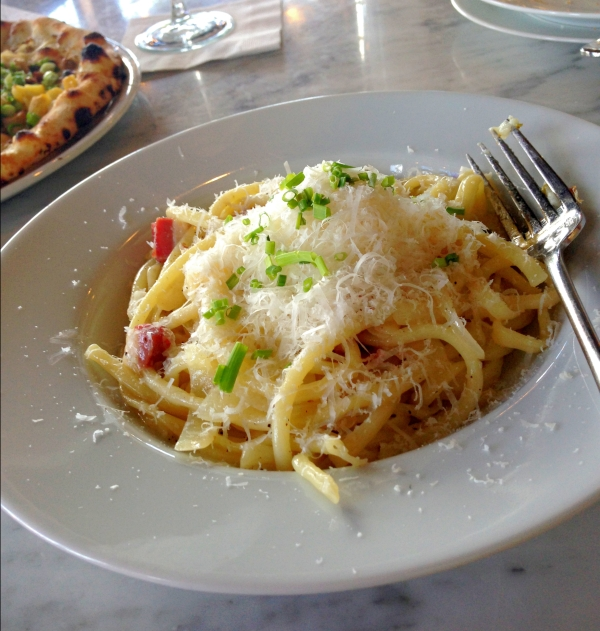 Pasta Carbonara: bucatini pasta, guanciale (fancy bacon), onions, soft-boiled egg, and grana padano cheese.
