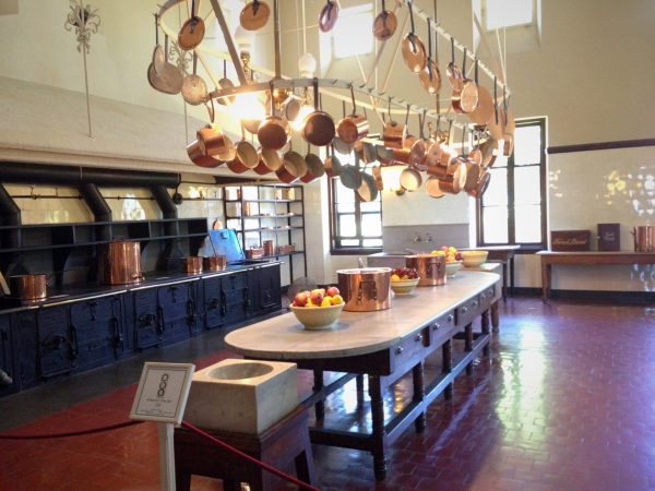 The massive kitchen with a single 21-foot coal-burning cast iron stove and a zinc work table.
